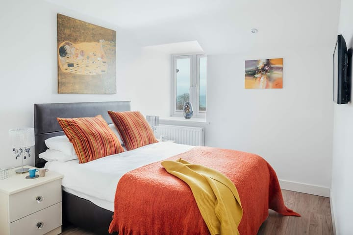 Master bedroom with double bed and views