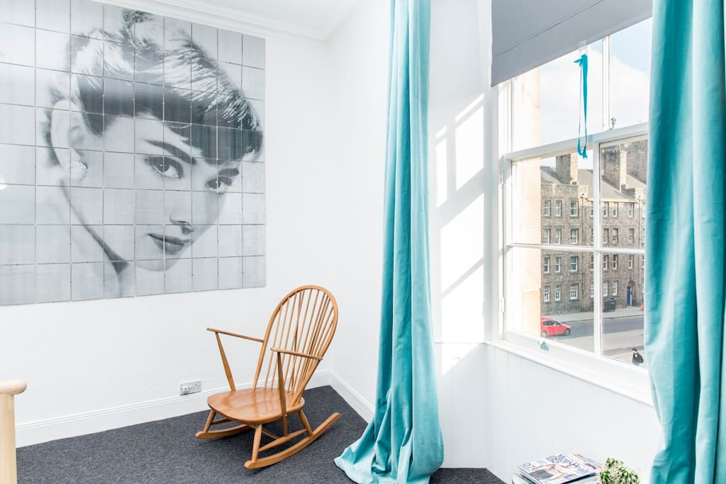 The double bedroom is large and has this fine spot for reading or rocking under Audrey Hepburn's gaze