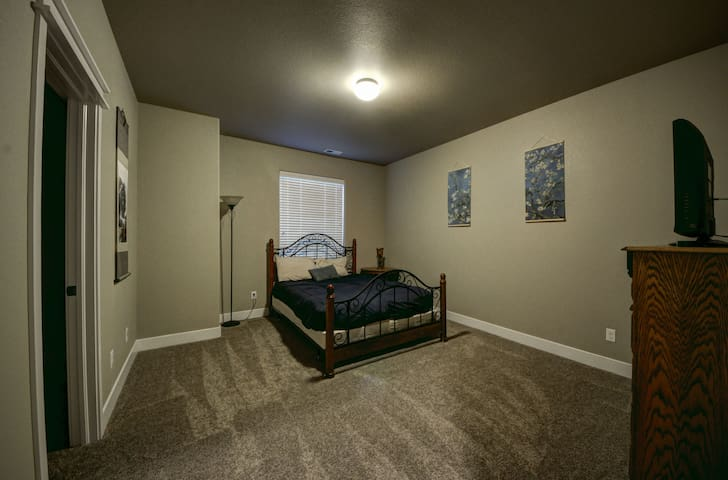 The spacious downstairs third guest bedroom has a queen bed.