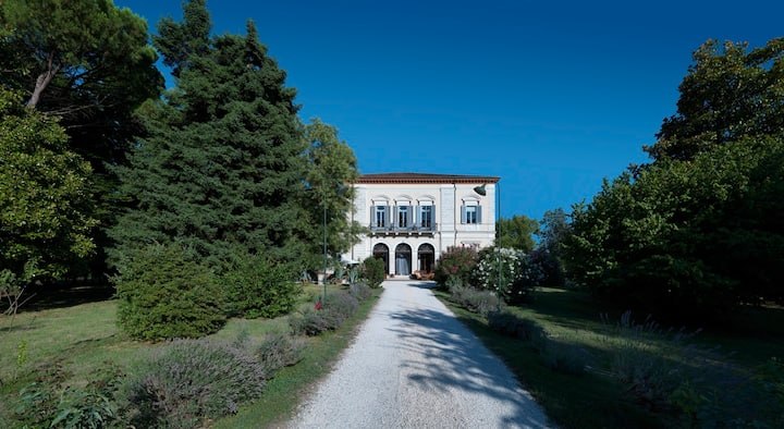 Historic villa surrounded by the trees