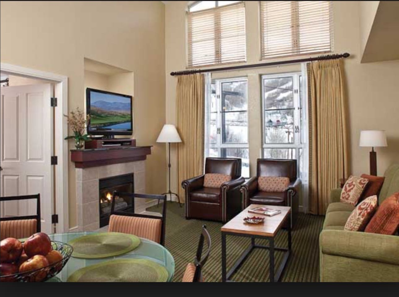 living Room with fireplace and view of the resort