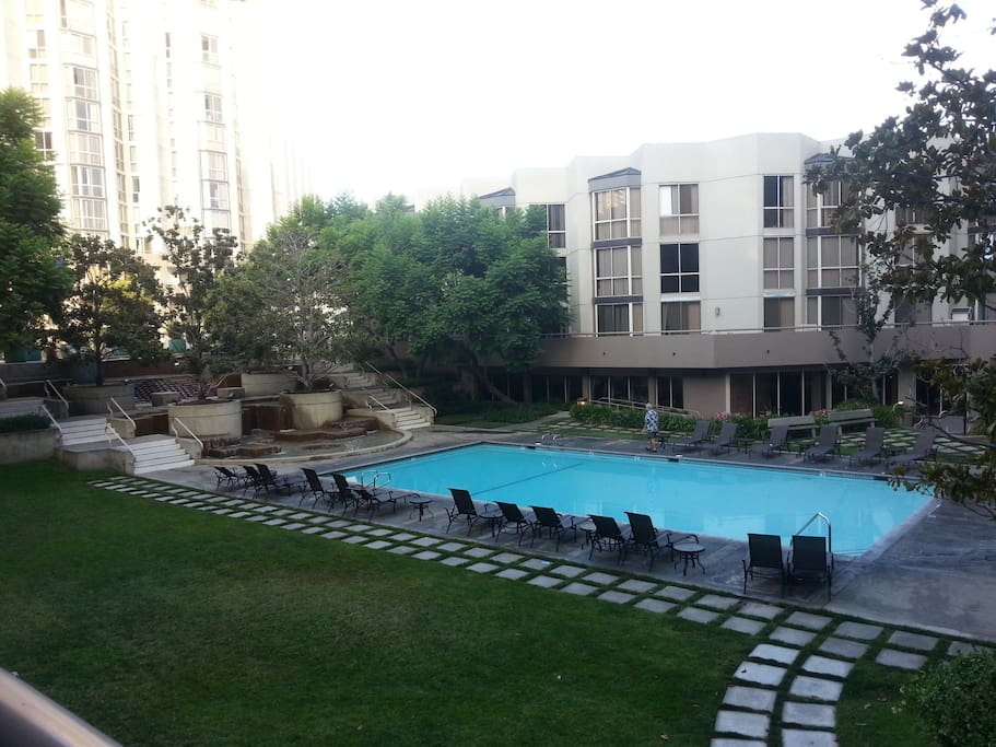 View of the pool, hot tub and gymnasium.