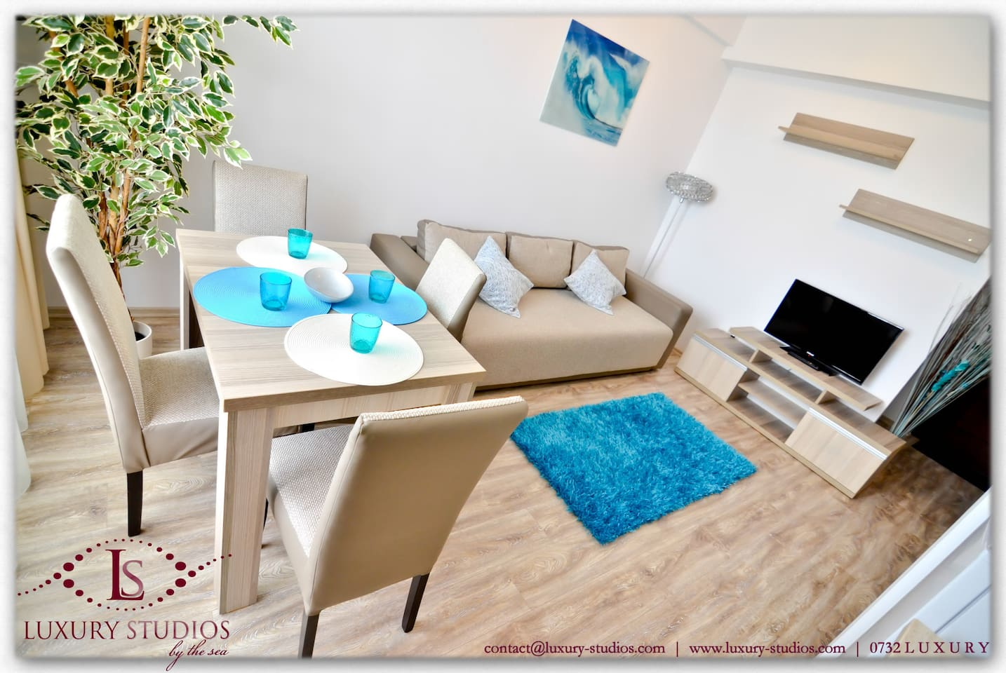 Open space living with air conditioning, finely furnished, extensible couch for 2 persons, table for 4 persons, modern decorations, plants, TV LCD, a large variety of TV channels, parental control for adult programmes, Sony PlayStation, collection of game
