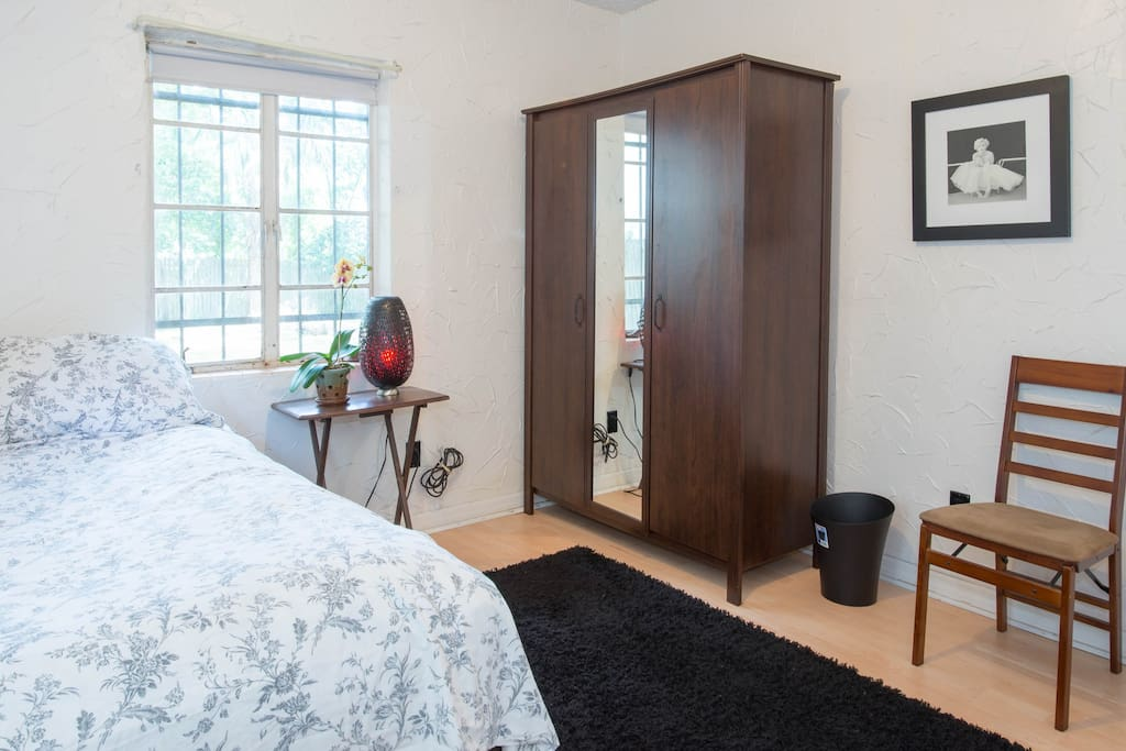 Armoire and bedside table, there is now a desk here as well if you need to get work done!