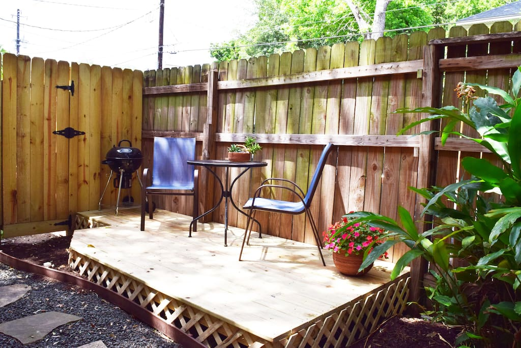 Enjoy fine dining at home! Private fenced patio includes charcoal grill and bistro table and chairs.