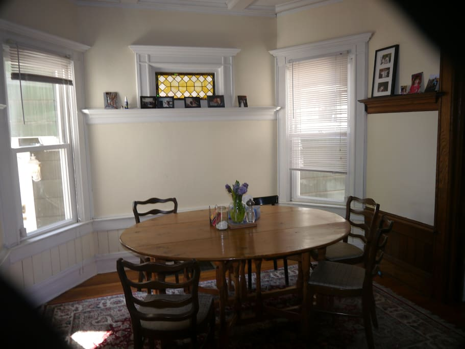 Dining room features original stained glass and Dutch tilework.