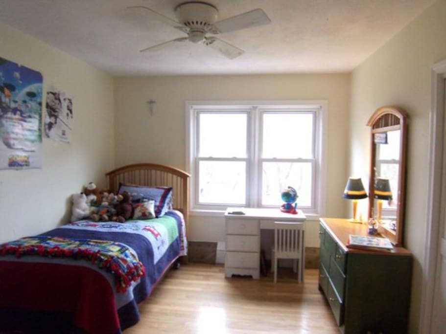 1 of three guest bedrooms