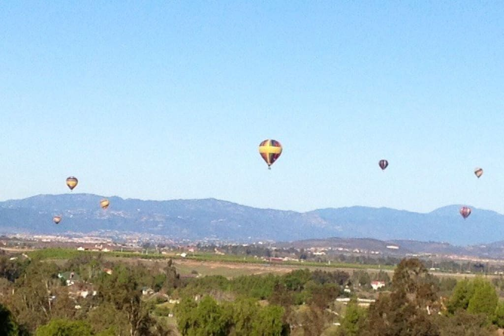 Open your eyes in the morning to a view of hot air balloons floating by