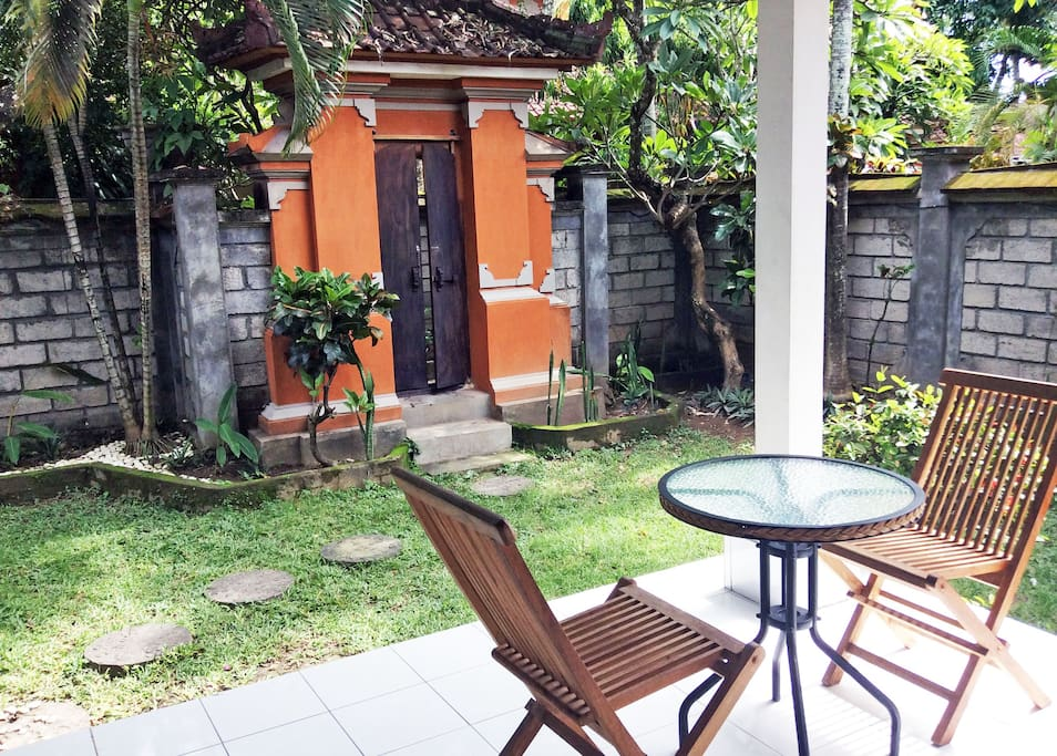 Large Patio with Seating Area Overlooking the Private Garden. Covered Patio Kitchen is attached at the front.