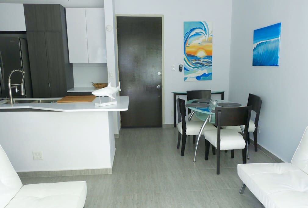 LIVING, KITCHEN AND DINNING AREA for four with air conditioner and 3 ceiling fans.