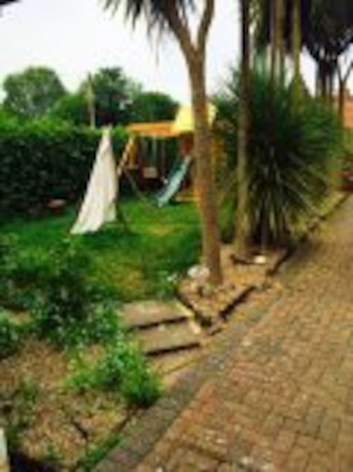Ideal haven for children with swings, slide, climbing frame and teepee