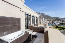 Private outdoor terrace with spa bath