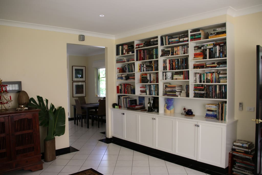 Sitting room with generous library, television, DVD and sound system.