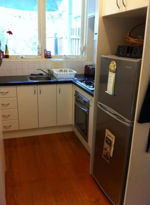 Separate kitchen with table and plenty of storage room