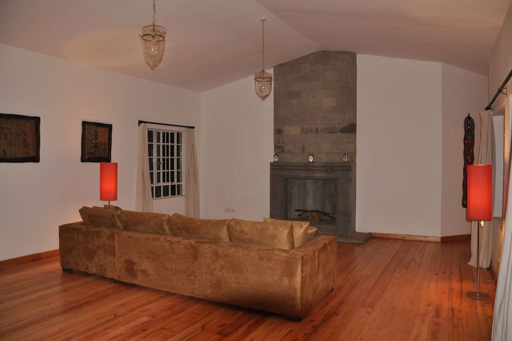Lovely sitting area with stone, hand carved fire place