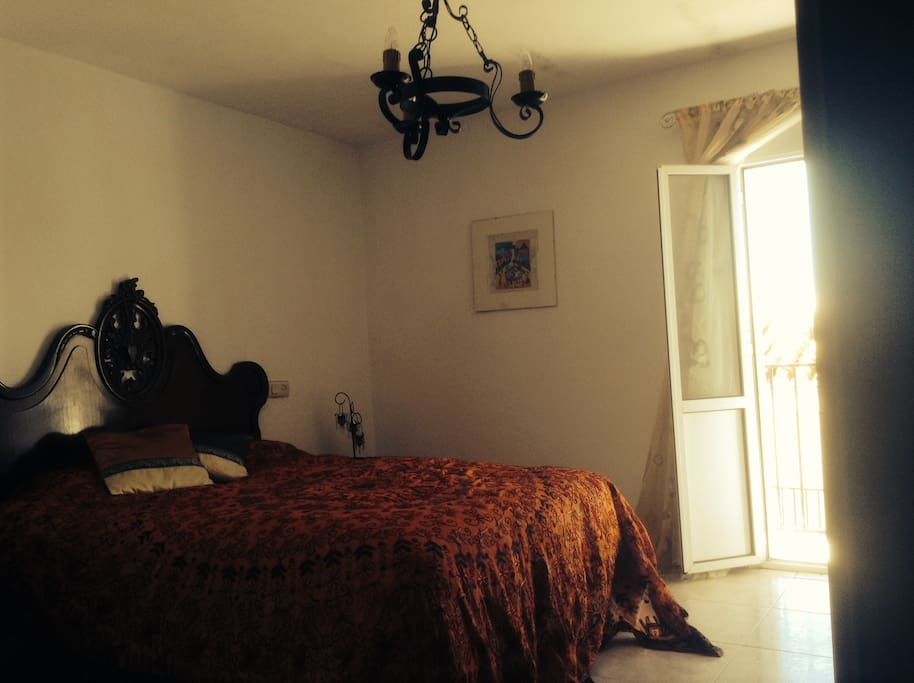 Cool and romantic Andaluz bedroom with Romeo and Juliet balcony..
