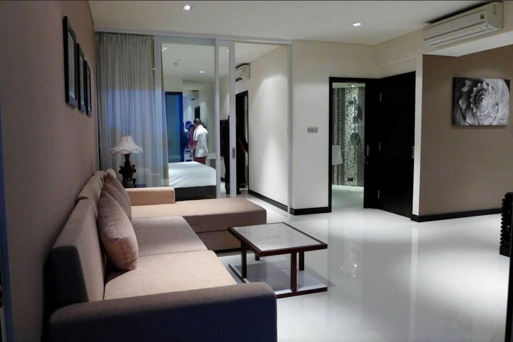 Salon area with big sofa & tea table