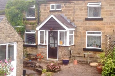 A delightful cosy two bedroom stone cottage
