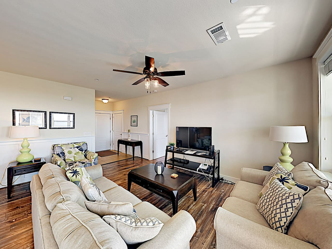 """Relax and watch your favorite shows on the 49"""" flat-screen TV in the living area."""