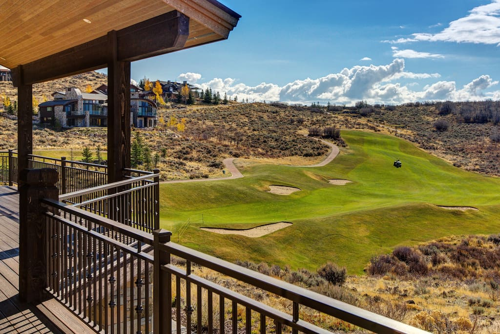 The manicured fairways of Pete Dye Golf Course are sprawled out below the house.