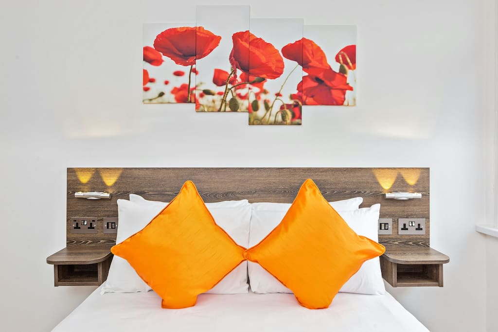 The comfortable King size bed is made up with hotel style linen, and has charging points and reading lights at the bed side