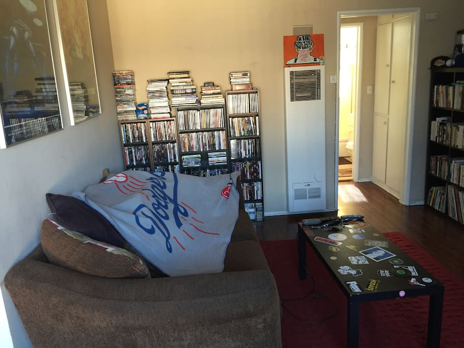 Living room with love seat/couch and may dvds to choose from and watch