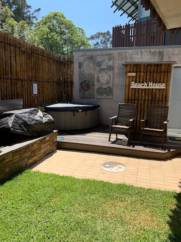 Outdoor spa and shower/toilet