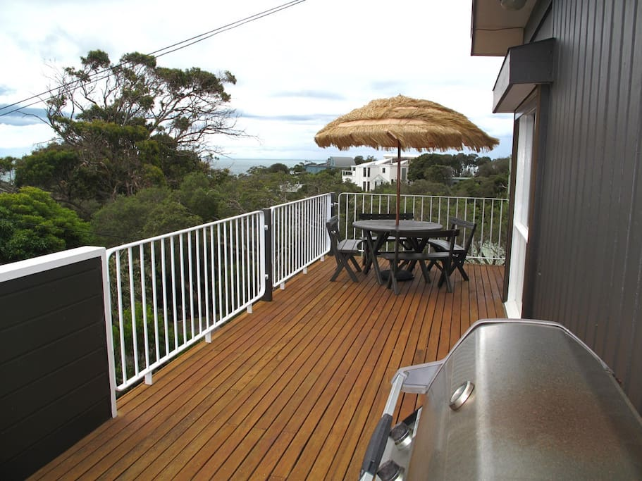 High Tide. BBQ and el fresco dining with tree tops and Bay view