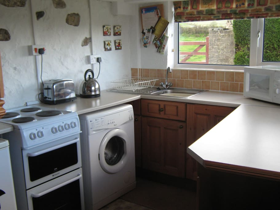 Fully functional kitchen with washing machine and Microwave.