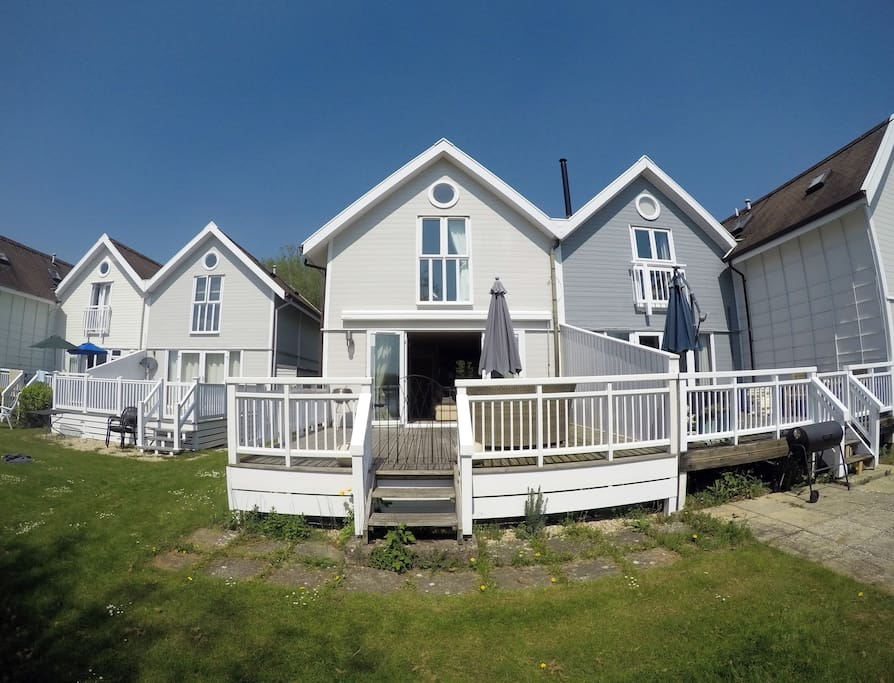 Rear of the lodge; decking area & master bedroom up top.