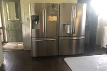 Two Large capacity refrigerators with pull out freezers for guest use
