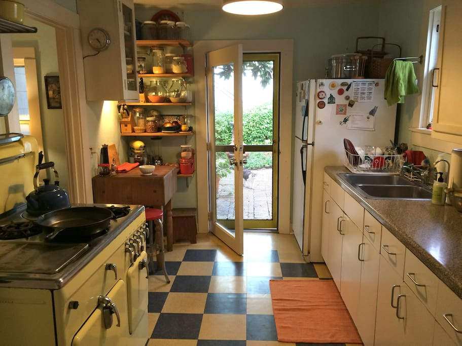 Kitchen opens to garden and patio.