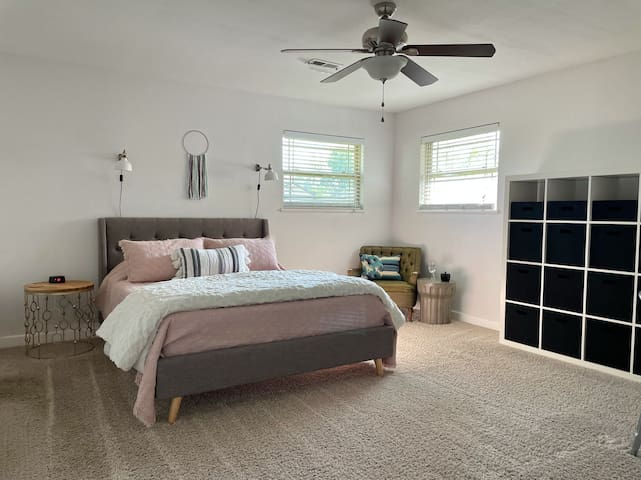 Master bedroom with Tuft & Needle Mint mattress, reading nook, and shelf space.