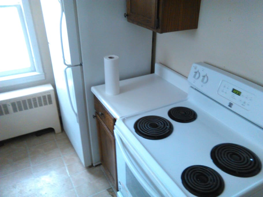 Kitchen, shared large fridge. Ample cooking gear.