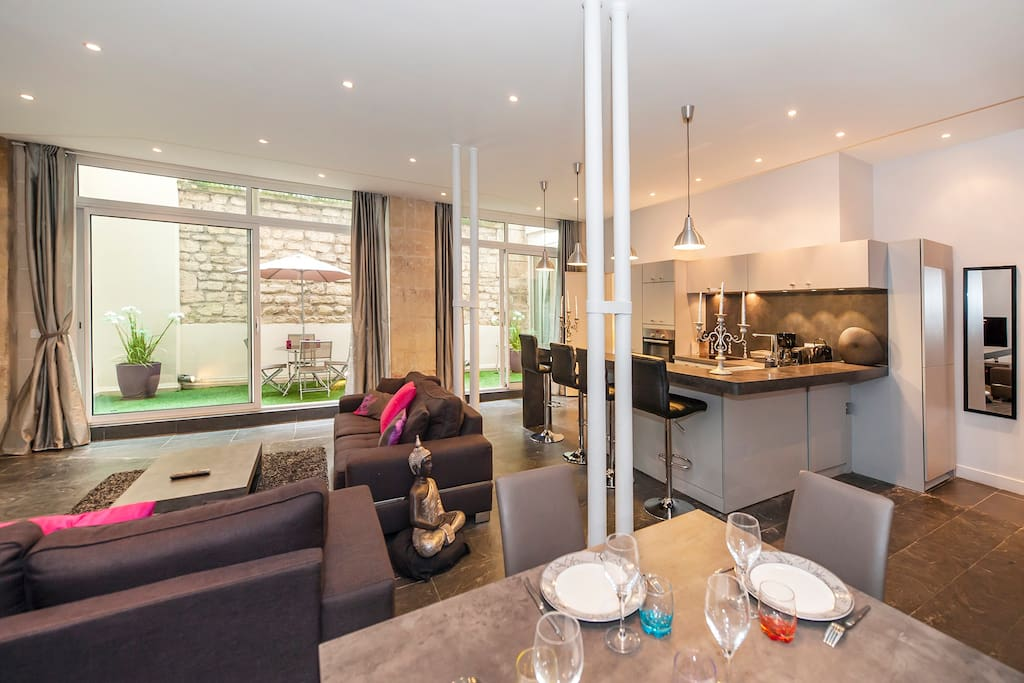 Living room, kitchen,  dining area and outdoor space.
