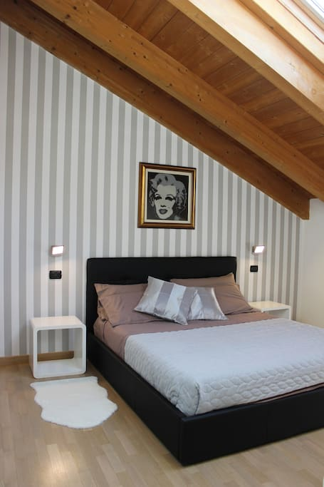 Bedroom with grey colors..