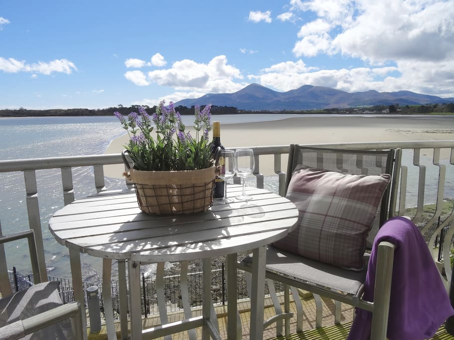 Breath-taking bay and Mourne Mountain views from the apartment balcony. living/kitchen/dining area and master bedroom!