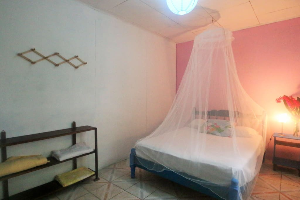 Main bedroom with a 2-person bed and a mosquito net around it.