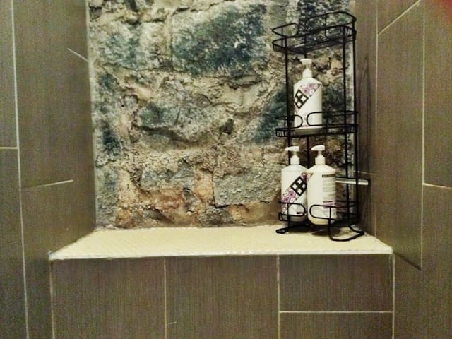 A bench is in the back of the shower.  We provide shampoo, conditioner, and body wash for your convenience