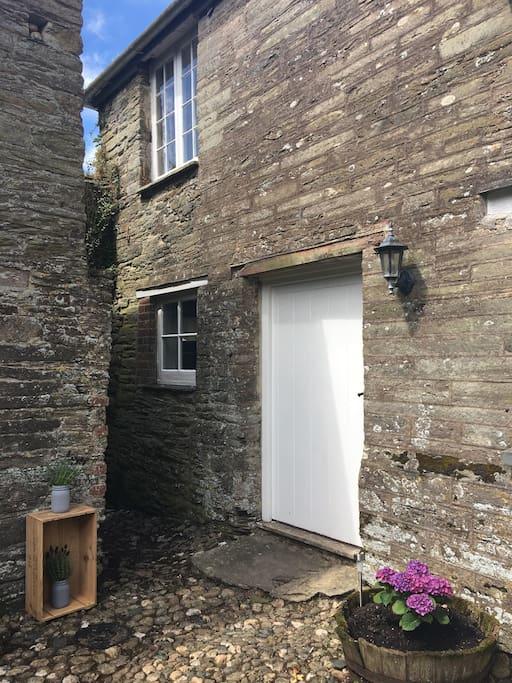Front door with bedroom window top left