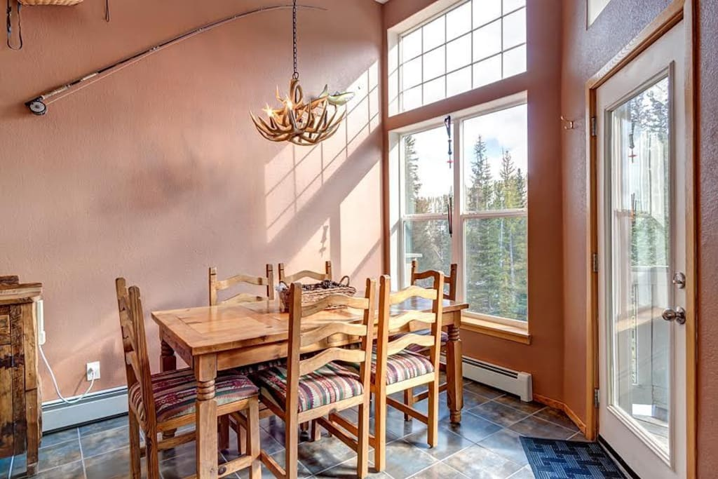 Enjoy dinner with a view at a rustic wood dining table.