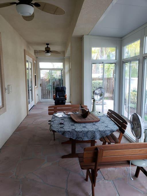 back yard sunroom with massage chair