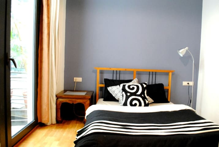 Spacious double bedroom, with balcony and private bathroom.