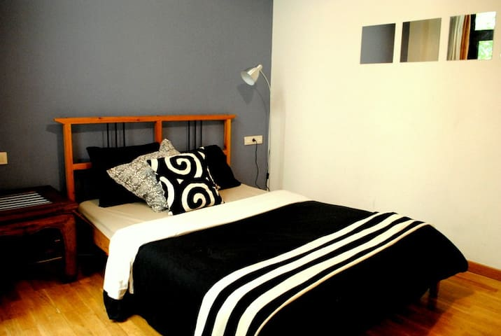 Spacious double bedroom, with balcony and private bath.
