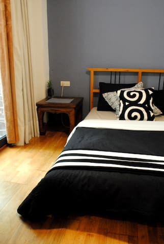 Spacious double bedroom, with balcony and private bathr.