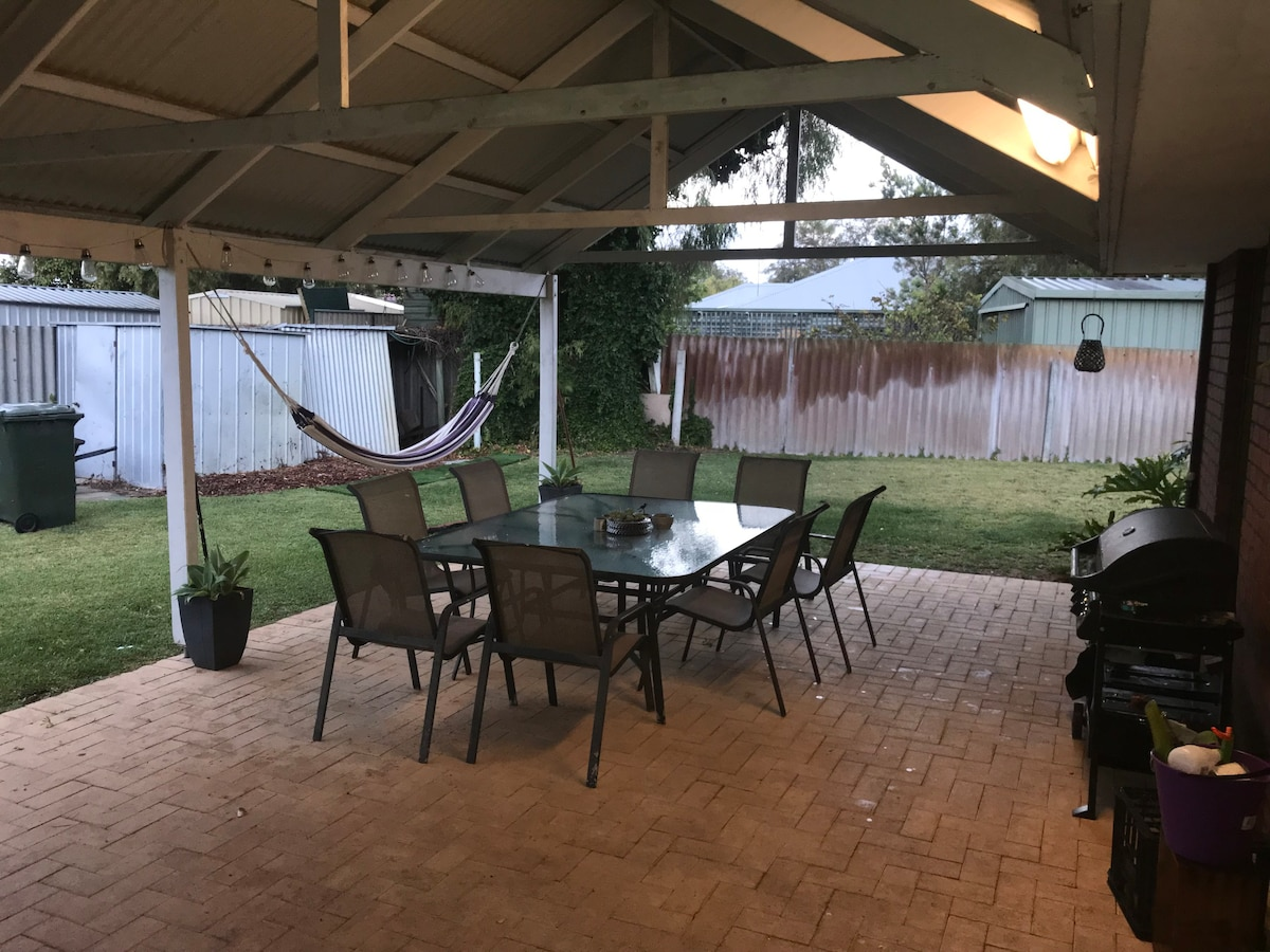 large outdoor entertaining area with bar fridge bbq and hammock for guest use  broadwater beach house   houses for rent in broadwater western      rh   airbnb