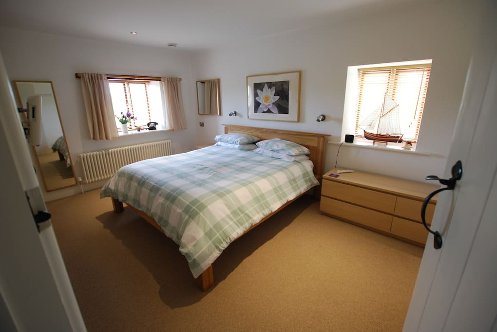 The very spacious, luxury bedroom has a super-kingsize bed, TV and an en-suite bathroom and shower.