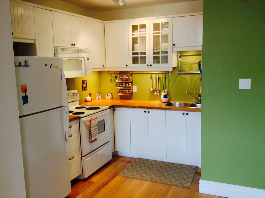 WHITE BEAUTIFUL KITCHEN WITH MICROWAVE AND ALL KITCHEN UTENSILS THAT MAY BE REQUIRED