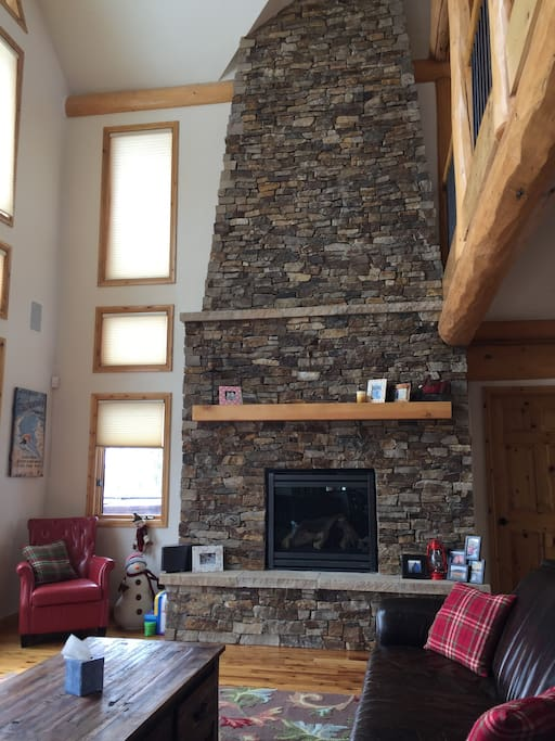 Gorgeous stone fireplace in the living room, just steps from the kitchen.
