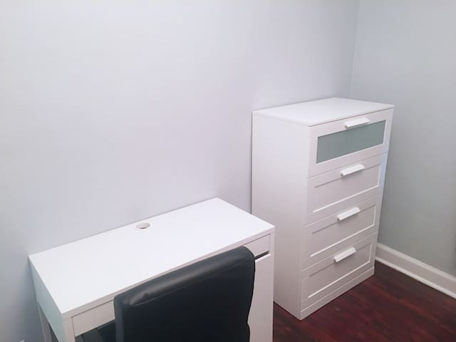 Your room comes with a new desk and the dresser is also available if you'd like to keep your clothes folded in it.